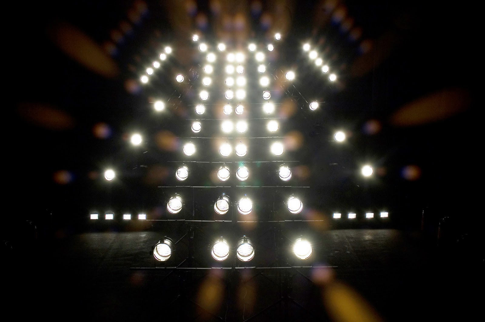 Formation of high wattage lamps. The lamps' electric current sound is looped loudly through a sound system.