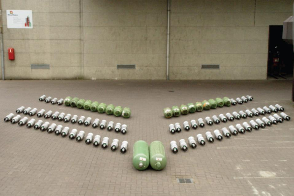 Gas cylinders. composition in site. Gas is heard leaking.