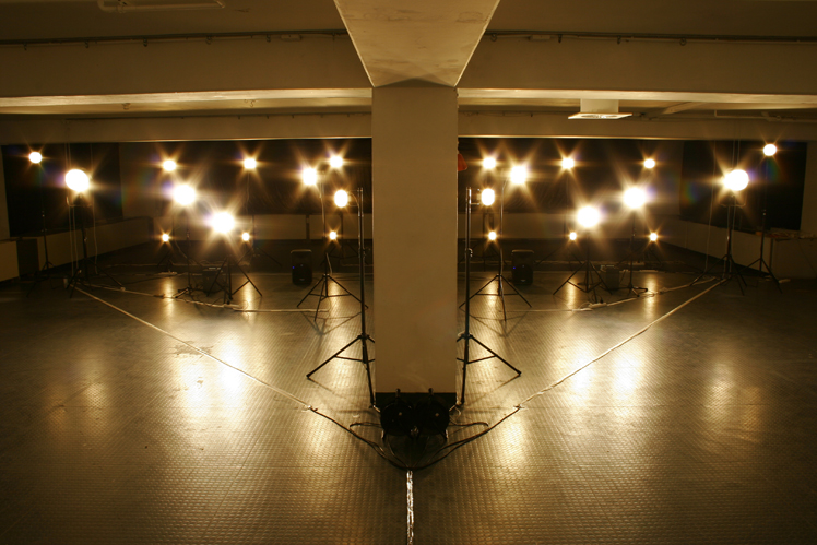 Idan Hayosh - Untitled (Lamps #9), 2007. Sound Installation. Formation of high wattage lamps. The lamps' electric current sound is looped loudly through a sound  system.